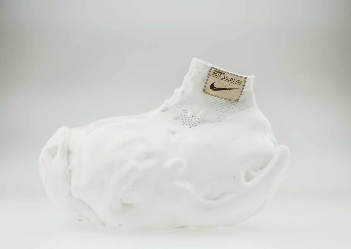This shoe was repeatedly dipped in PU foam, which never fully compresses no matter how hard the runner goes. It's supposed to erase the feel of impact when the foot hits the ground.