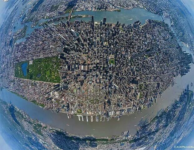 A breathtaking aerial view of Manhattan, New York, taken from a helicopter with a fish-eye lens.