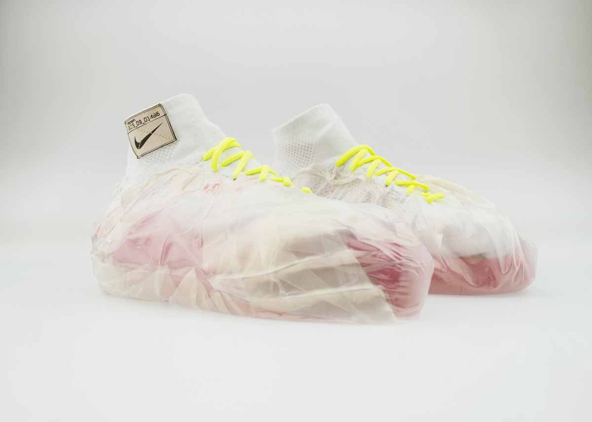 Plastic bags filled with kinetic sand are wrapped around these shoes for impact protection.